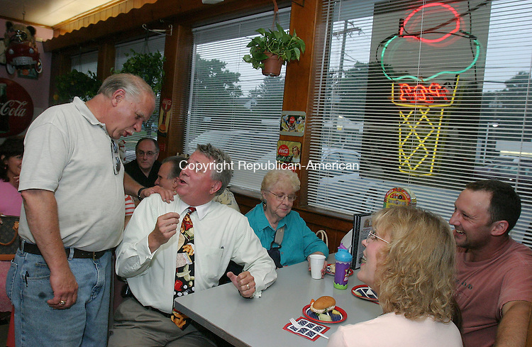 PROSPECT, CT 18 July 2005 -071805BZ07- From left- John F. Jones, co-owner of the Prospect Dairy Bar, talks with Prospect Mayor Bob Chatfield, who sat to talk with his neighbor Bernice Wilson, and Alla Sivakoff, D.V.M., of Prospect,  her daughter Carley Allen, 2, of Prospect,  and her husband Tom Allen, of Prospect,  at the Dairy Bar Monday night.  Minutes before Chatfield announced he would seek re-election for a record 15th consecutive term as Mayor.  <br /> According to Allen, Chatfield is a distant cousin.<br /> Jamison C. Bazinet Photo