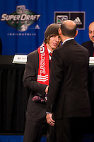 CD Chivas USA first round draft pick, and seventh overall, John Cunliffe shakes hands with MLS Commissioner Don Garber during the first round of the MLS SuperDraft at the Indiana Convention Center, Indianapolis, IA, on Jan 12, 2007.