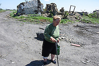 A woman walking along country road near Nikishine village, 20 June 2015