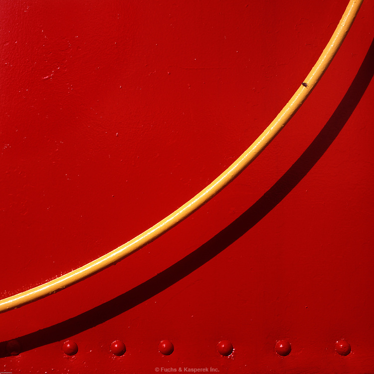 A solitary fly sits on a handrail of a red caboose at the Rail Museum in Salamanca, New York.