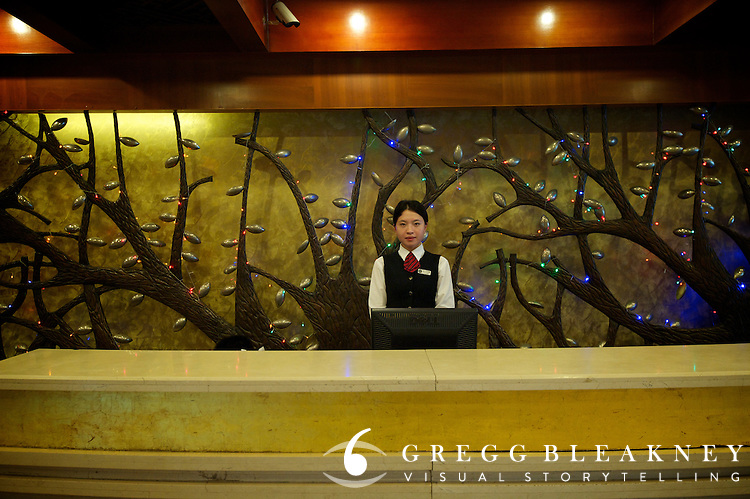 Stage 2's Dragon Spring Hotel receptionist - 2011 Tour of Beijing Scouting Photos