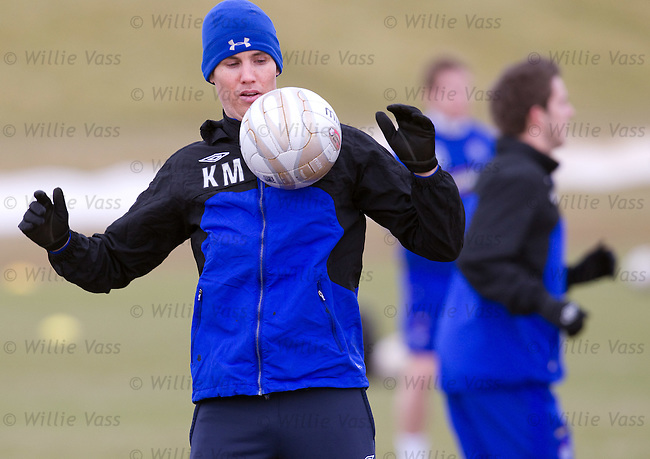 Kenny Miller watches the ball