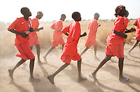 The young women of the Turalei team on their way to a volleyball match at the Twic Olympics in Wunrok, Southern Sudan.
