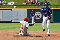 Round Rock Express shortstop Luis Sardinas (15) turns a double play as Memphis Redbirds baserunner Pete Kozma (8) slides into second base during the first game of a Pacific Coast League doubleheader on August 3, 2014 at the Dell Diamond in Round Rock, Texas. The Redbirds defeated the Express 4-0. (Andrew Woolley/Four Seam Images)