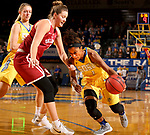 BROOKINGS, SD - DECEMBER 6: Alexis Alexander #1 from South Dakota State looks to get a step past McKenna Treece #30 from Oklahoma during their game Wednesday night at Frost Arena in Brookings. (Photo by Dave Eggen/Inertia)