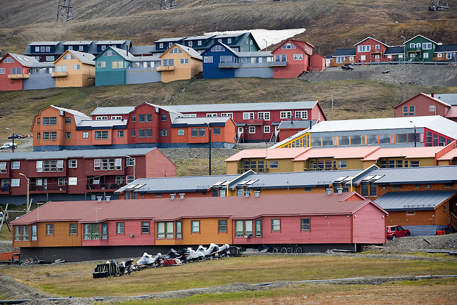 Wooden homes on the hillside in Longyearbyen, all raided on legs to prevent thawing the permafrost. Spitsbergen. Norway