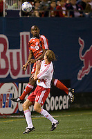 Toronto FC midfielder Marvell Wynne (16) heads the ball over New York Red Bulls midfielder Dave van den Bergh (11). Toronto FC defeated the New York Red Bulls 3-1 during a Major League Soccer match at Giants Stadium in East Rutherford, NJ, on October 04, 2008. Photo by Howard C. Smith/isiphotos.com
