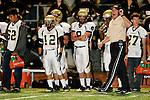 Torrance, CA 09/10/10 - Nathan Jo (Peninsula #12), Caleb Brackenbury (Peninsula #27), Taylor Young (Peninsula #8), Brian Jeon (Peninsula #62) and Coach Moen  in action during the Peninsula Panthers-North Saxons Varsity football game at North Torrance High School.