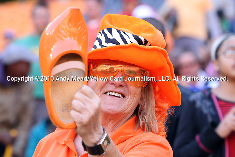 14 JUN 2010:  Dutch fan in the stands with a wooden shoe.  The Netherlands National Team played the Denmark National Team at Soccer City Stadium in Johannesburg, South Africa in a 2010 FIFA World Cup Group E match.