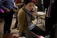 A Romney staffer answers a phone call at the Romney New Hampshire campaign headquarters in Manchester, New Hampshire, on Jan. 7, 2012. Romney is seeking the 2012 Republican presidential nomination.