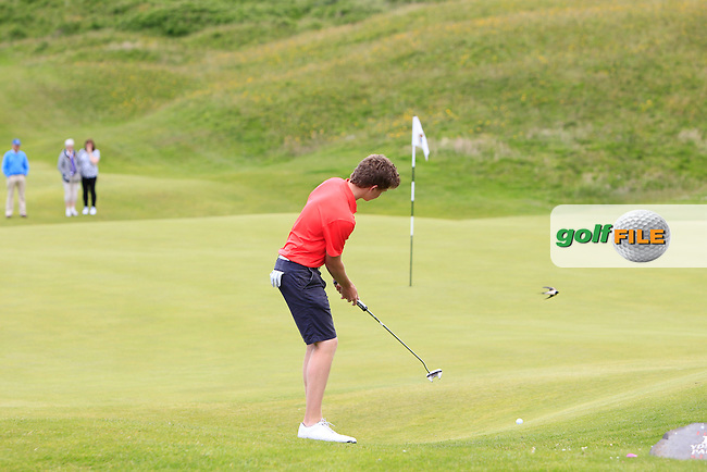 Marc McKinstry (Cairndhu) on the 10th green during Round 1 Matchplay of the North of Ireland Amateur Open Championship at Royal Portrush, Dunluce Course on Wednesday 15th July 2015.<br /> Picture:  Golffile | Thos Caffrey