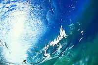 Wave with surfer in the tube, North shore Oahu