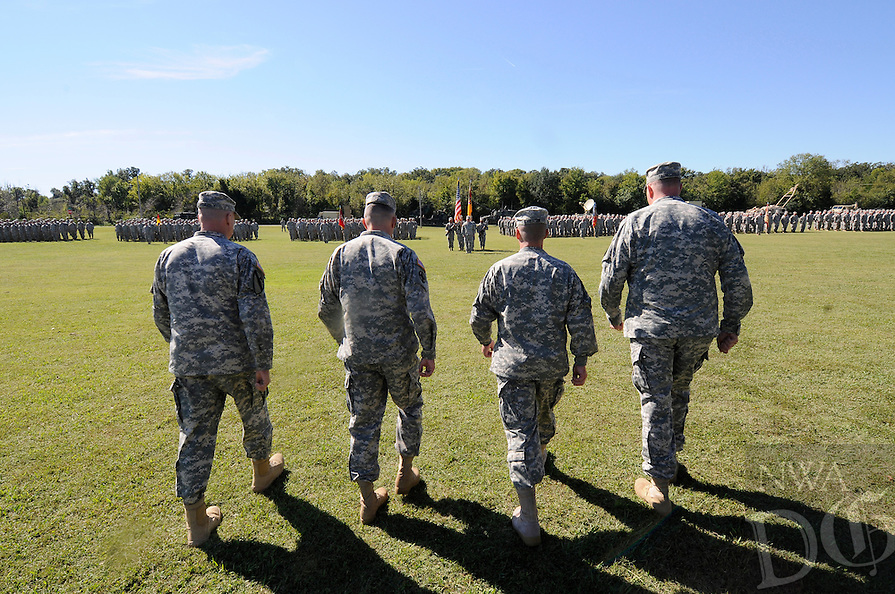 NWA Media/ J.T. Wampler -Col. Gregory &ldquo;Greg&rdquo; C. Bacon of Conway assumed command of the 142nd Field Artillery Bridgade from outgoing commander Col. Troy D. Galloway during a change of command ceremony Oct. 4, 2014. <br /> <br /> The change of command was followed by a change of responsibility between Command Sgt. Maj. Todd C. Schroeder, outgoing Senior Enlisted Leader, and Command Sgt. Maj. Anthony &ldquo;Tony&rdquo; Rice, incoming Senior Enlisted Leader for the brigade.<br /> <br /> The 142nd Field Artillery Brigade served in every major U.S. conflict, with the exception of Vietnam, since World War I; most recently deploying multiple units during Operation Iraqi Freedom and Operation Noble Eagle.
