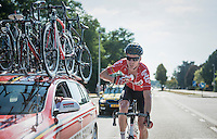 Marcel Sieberg (DEU/Lotto-Soudal) getting water bottles from the team car just before he would crash out of the race...<br /> <br /> 12th Eneco Tour 2016 (UCI World Tour)<br /> Stage 6: Riemst › Lanaken (185km)