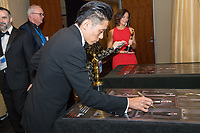 Kazuhiro Tsuji signs a poster backstage with the Oscar&reg; for achievement in makeup for work on &ldquo;Darkest Hour&rdquo; during the live ABC Telecast of The 90th Oscars&reg; at the Dolby&reg; Theatre in Hollywood, CA on Sunday, March 4, 2018.<br /> *Editorial Use Only*<br /> CAP/PLF/AMPAS<br /> Supplied by Capital Pictures