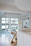 Crisp, modern kitchen design in a Richmond home. Custom carved stools.