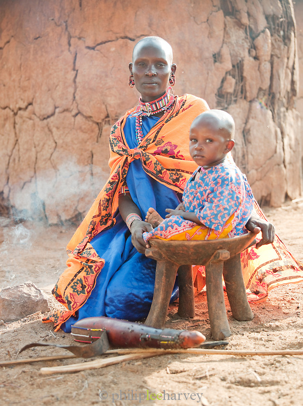 A mother and child making a fire, Tipilit Village near Amboseli National Park, Kenya