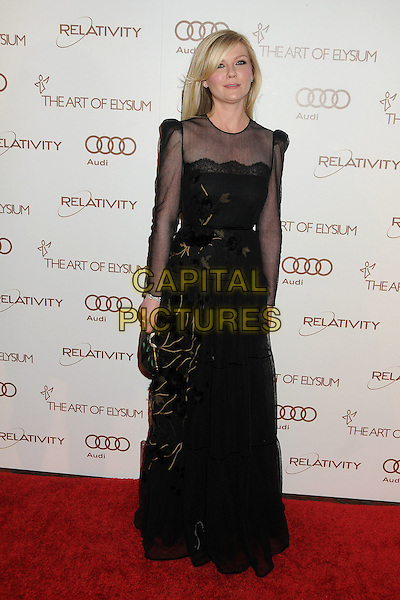 Kirsten Dunst.5th Annual Art Of Elysium Heaven Gala held at Union Station, Los Angeles, California, USA, 14th January 2012..arrivals full length long sleeve sheer black dress long maxi  lace see thru through clutch bag .CAP/ADM/BP.©Byron Purvis/AdMedia/Capital Pictures.