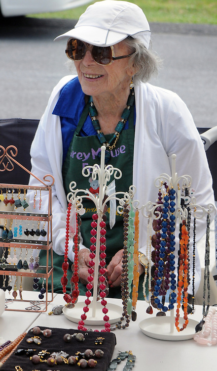 Grey Mouse Farm, matriarch, Sallie P. Kreda, at the Farm's booth at the weekly Saugerties' Farmer's Market in Saugerties, NY on Saturday, July 2, 2016. Photo by Jim Peppler. Copyright Jim Peppler 2016.