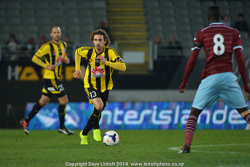 Alberto Riera in action during the Football United Tour match between Wellington Phoenix and West Ham United at Eden Park, Auckland, New Zealand on Wednesday, 23 July 2014. Photo: Dave Lintott / lintottphoto.co.nz