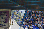 A small section of home supporters craning their necks for a better view in the Tilton Road stand at St. Andrew's stadium, during Birmingham City's Barclay's Premier League match with Wolverhampton Wanderers. Both clubs were battling against relegation from  England's top division. The match ended in a 1-1 draw, watched by a crowd of 26,027.