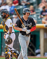 Jamie Romak (4) of the El Paso Chihuahuas walks back to the dugout against the Salt Lake Bees in Pacific Coast League action at Smith's Ballpark on April 30, 2017 in Salt Lake City, Utah. El Paso defeated Salt Lake 3-0. This was Game 1 of a double-header. (Stephen Smith/Four Seam Images)
