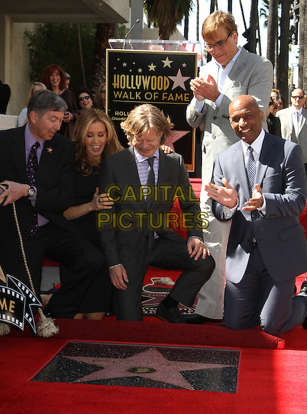 Leron Gruber, Felictiy Huffman And William H Macy, Aaron Sorkin.Felictiy Huffman And William H. Macy Hollywood Walk Of Fame Induction Ceremony Held At On the Walk of Fame, Hollywood, California, USA.  .March 7th, 2012.full length moustache mustache facial hair married husband wife black suit glasses suit kneeling looking down.CAP/ADM/KB.©Kevan Brooks/AdMedia/Capital Pictures.