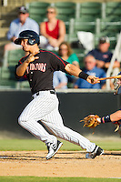 Eric Grabe (18) of the Kannapolis Intimidators follows through on his swing against the Rome Braves at CMC-Northeast Stadium on August 25, 2013 in Kannapolis, North Carolina.  The Intimidators defeated the Braves 9-0.  (Brian Westerholt/Four Seam Images)