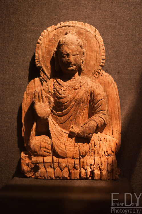 Seated Buddha, wood t-7th century AD, Mes Aynak (logar Province, Afghanistan). This seated figure of a Buddha is the only complete example in wood to have survived. The buddha is seated in meditation posture on a lotus seat. Kabul National Museum