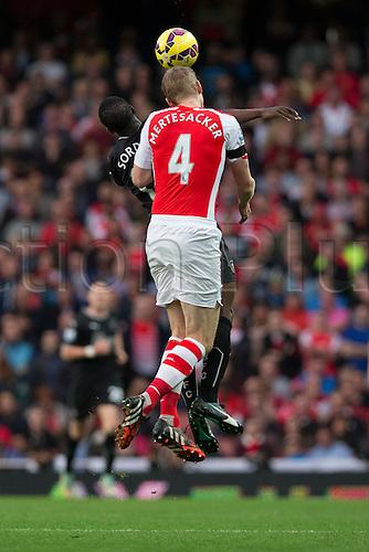 01.11.2014.  London, England. Premier League. Arsenal versus Burnley. Forward Marvin Sordell loses a header against defender Per Mertesacker.