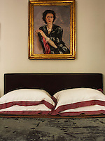 A 1948 portrait of Nicolo's grandmother hangs above the bed in the master bedroom. The bed linen is by C&C Milano, founded by Nicolo's father