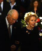 Washington, D.C. - June 9, 2004 -- United States Vice President Dick Cheney, left, escorts former first lady Nancy Reagan to her husband's coffin in the rotunda of the United States Capitol in Washington, D.C. on June 9, 2004.<br /> Credit: Ron Sachs / CNP