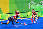Melissa Gonzalez #5 of United States passes the ball into the circle during Great Britain vs USA in a women's Pool B game at the Rio 2016 Olympics at the Olympic Hockey Centre in Rio de Janeiro, Brazil.