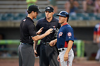 Potomac Nationals manager Tripp Keister (7) talks with umpire Mark Bass (left) and home plate umpire Mike Snover (center) after the first game of a doubleheader against the Lynchburg Hillcats on June 9, 2018 at Calvin Falwell Field in Lynchburg, Virginia.  Lynchburg defeated Potomac 5-3.  (Mike Janes/Four Seam Images)