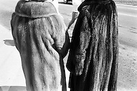 Two woman dressed with fur coats