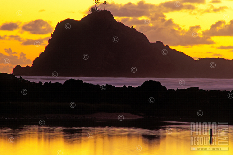 Haneoo Fishpond at dusk with Alau island in the background, Hana