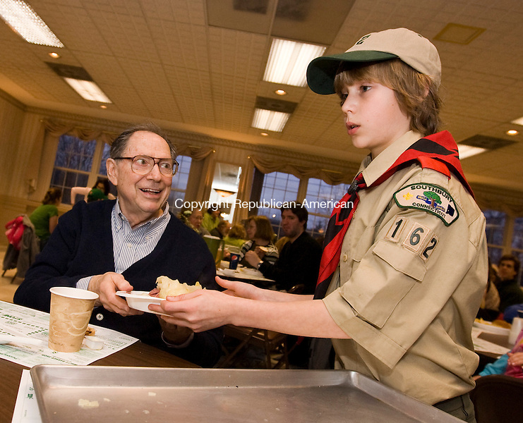 Southbury, CT-13, March 2010-031310CM07 Gavin Nealon, 10 of Southbury, serves Henry Duffy of Heritage Village, a corned beef and cabbage dinner Saturday night at the Southbury Volunteer Fire Department.  Nealon was with his Boy Scout Troop 162, out of Southbury, serving the dinners.  Chief Gilbert (Southbury Volunteer Fire Department) said the dinner is in it's 10th year and served approximately 500 pounds of corned beef.           --Christopher Massa Republican-American