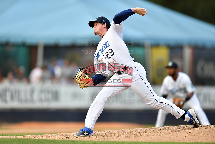Asheville Tourists starting pitcher Nick Bush (29) delivers a pitch during a game against the Greenville Drive at McCormick Field on July 10, 2019 in Asheville, North Carolina. The Tourists defeated the Drive 1-0. (Tony Farlow/Four Seam Images)