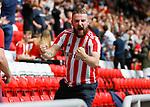 A Sunderland fan celebrates the equalising goal scored by Jordan Willis. Sunderland 2 Portsmouth 1, 17/08/2019. Stadium of Light, League One. Photo by Paul Thompson.