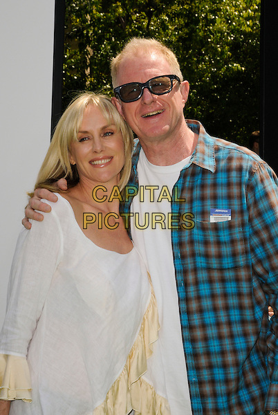 "RACHELLE CARSON BEGLEY, ED BEGLEY JR. .arriving at the Los Angeles premiere of Dreamworks Animation's ""Shrek Forever After"" at Gibson Amphitheatre in Universal City, California, .May 16th, 2010.half length couple white cream ruffle top blue plaid shirt married husband wife sunglasses  .CAP/ROT.©Lee Roth/Capital Pictures"