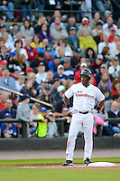 Hall of Fame outfielder Rickey Henderson on third base in front of a packed stadium during the MLB Pepsi Max Field of Dreams game on May 18, 2013 at Frontier Field in Rochester, New York.  (Mike Janes/Four Seam Images)