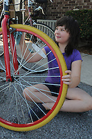 NWA Democrat-Gazette/FLIP PUTTHOFF<br /> Robbie Rheam (cq), 9, cleans the wheels of repaired bicycles Saturday August 8 2015 at First Christian Church in Bentonville.