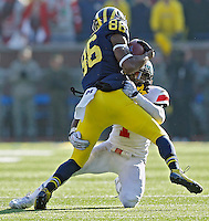 Ohio State Buckeyes cornerback Bradley Roby (1) makes a tackle on Michigan Wolverines wide receiver Jehu Chesson (86) in the 3rd quarter of their college football game at Michigan Stadium in Ann Arbor, Michigan on November 30, 2013.  (Dispatch photo by Kyle Robertson)