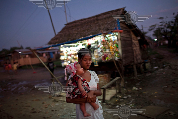 A woman walks through the Hlaing Thaya slum district of Yangon.