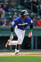 Second baseman Luis Alejandro Basabe (5) of the Greenville Drive bats in a game against the Asheville Tourists on Sunday, April 10, 2016, at Fluor Field at the West End in Greenville, South Carolina. Greenville won 7-4. (Tom Priddy/Four Seam Images)