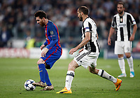 Football Soccer: UEFA Champions UEFA Champions League quarter final first leg Juventus-Barcellona, Juventus stadium, Turin, Italy, April 11, 2017. <br /> Barcellona's Lionel Messi (l) in action with Juventus Giorgio Chiellini (r) during the Uefa Champions League football match between Juventus and Barcelona at the Juventus stadium, on April 11 ,2017.<br /> UPDATE IMAGES PRESS/Isabella Bonotto