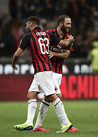 Calcio, Serie A: AC Milan - AS Roma, Milano stadio Giuseppe Meazza (San Siro) 31 agosto 2018. <br /> AC Milan's Patrick Cutrone (r) celebrates with his teammates Gonzalo Higuain (l) after winning 2-1 the Italian Serie A football match between Milan and Roma at Giuseppe Meazza stadium, August 31, 2018. <br /> UPDATE IMAGES PRESS/Isabella Bonotto
