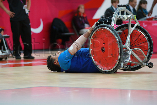 05.09.2012 London, England. mixed wheelchair rugby pool phase group A, match no4 (JPN) vs (FRA) R Sallem (FRA) lays on his back on the floor in action during Day 7 of the London 2012 Paralympic Games in the Basketball Arena Stratford