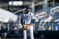 Tri-City Dust Devils relief pitcher Joe Galindo (12) gets ready to deliver a pitch during a Northwest League game against the Everett AquaSox at Everett Memorial Stadium on September 3, 2018 in Everett, Washington. The Everett AquaSox defeated the Tri-City Dust Devils by a score of 8-3. (Zachary Lucy/Four Seam Images)