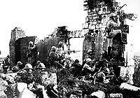 French troopers under General Gouraud, with their machine guns amongst the ruins of a cathedral near the Marne, driving back the Germans.  1918. Central News Photo Service. (War Dept.)<br /> Exact Date Shot Unknown<br /> NARA FILE #:  165-WW-286-36<br /> WAR & CONFLICT BOOK #:  619